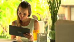 Young businesswoman sitting with tablet  at home HD Stock Footage