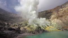 Mining Operation and Acid Lake at Kawah Ijen Volcano, East Java, Indonesia Stock Footage