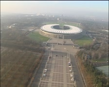 Flight above Olympic stadium, very low altitude, from gate to bell tower Stock Footage