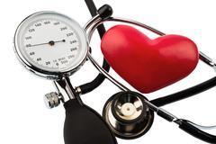 sphygmomanometer and heart - stock photo