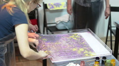 Beautiful pattern printing on silk shawl from water surface. The Ebru Stock Footage