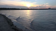 4k Flat waves beach Timmendorfer Strand sunset at end of day Stock Footage