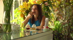 Pretty woman eating breakfast by dinning table at home HD Stock Footage