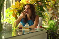 Pretty woman eating breakfast by dinning table at home NTSC Stock Footage