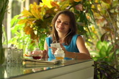 Young woman listening to the music by dinning table at home NTSC Stock Footage