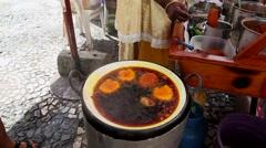 Baiana Doing a Acaraje - Acaraje is a typical food from Bahia Stock Footage