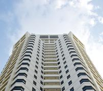 white high building hotel tower residential and sky - stock photo