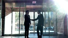 4K Video Two Professional Businessmen Enter Building Lobby and Shake Hands Stock Footage