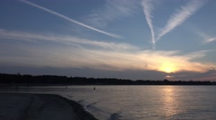 4k Late sunset pan at beach Timmendorfer Strand flying seagulls Stock Footage