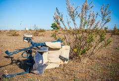 trash in shantytown - abandoned stroller - stock photo
