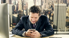Business man writing text message with cell phone while talking Stock Footage
