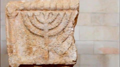 Menorah on the limestone bloke.6 century AD  Jerusalem Stock Footage