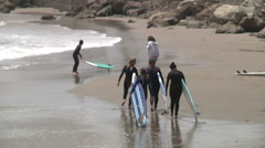 Teen Surfer Girls Drag Surfboards Along Beach- Soft Focus Stock Footage