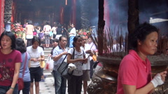 People praying god with incense in Dajia Jenn Lann Temple Stock Footage