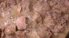 Roast meat in a skillet. 4K. Stock Footage