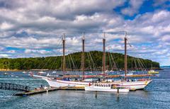 sailing ship in the harbor at bar harbor, maine. - stock photo