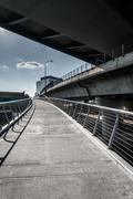 Bike path under the zakim bridge in boston, massachusetts. Stock Photos