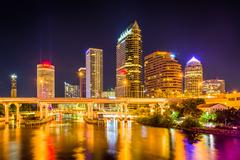 the skyline and bridges over the hillsborough river at night in tampa, florid - stock photo