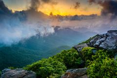 Sunset through fog, seen from craggy pinnacle, near the blue ridge parkway, n Stock Photos