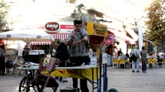 Jewish guy putting Tefillin in Ben Yehuda Street. Jerusalem. Israel Stock Footage