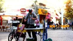 Stock Video Footage of Jewish guy putting Tefillin in Ben Yehuda Street. Jerusalem. Israel