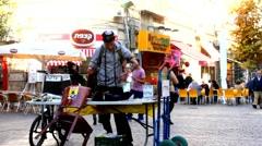 Jewish guy putting Tefillin in Ben Yehuda Street. Jerusalem. Israel - time lapse - stock footage