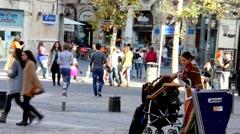Street violinist and visitors in Ben Yehuda Street. Jerusalem. Israel - stock footage