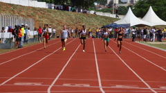 Sportsmen run on track. Race. Runners. Athletes. Starting Line. 100m Women Stock Footage