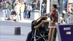 Stock Video Footage of Street violinist and visitors in Ben Yehuda Street. Jerusalem. Israel