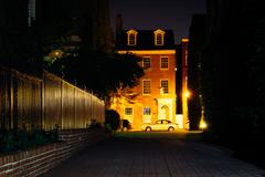 old brick house and alley at night, in fells point, baltimore. - stock photo