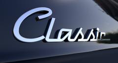 Classic chrome car emblem Stock Illustration
