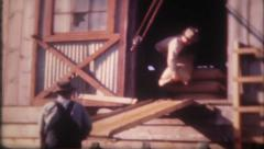 1315 - farm hands are loading supplies on the truck - vintage film home movie Stock Footage
