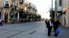 Visitors  and new tram in Jaffo Street.  Jerusalem. Israel Stock Footage