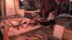 Macao. People buying fish in the Red market in Macau Stock Footage