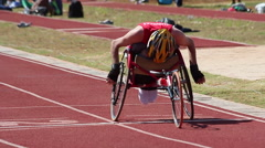 Paralympic games.Wheelchair. Runners. Track. Games. Stock Footage