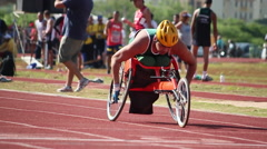 Paralympic games.Wheelchair. Runners. Track. Olympic games. Stock Footage