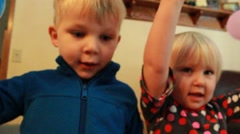 Boy and Girl clapping with balloons Stock Footage