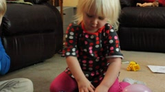Girl reassembles toy pie Stock Footage
