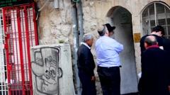 Religious Jews around the old synagogue on the  Yoel Moshe Salomon Street. Jerus Stock Footage