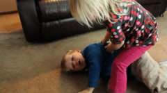 Girl and boy wrestle and kick each other - stock footage