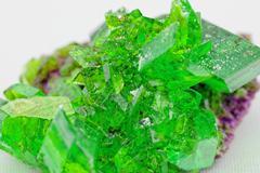 Crystal macro photo in emerald color Stock Photos