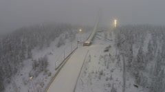 Ski jump in Lapland with low artificial lightning Stock Footage