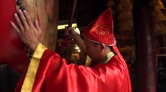 Macau, A-Ma Temple, Ma Kok Miu, monk beat a drum Stock Footage