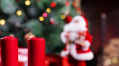 Set Afire of Candles beside a  Christmas tree Stock Footage