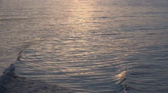 4k Sunset reflection on water near beach Stock Footage