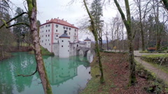 Flying towards castle surrounded in water Stock Footage