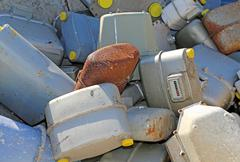 rusted gas counters in a special waste landfill in eastern europe - stock photo