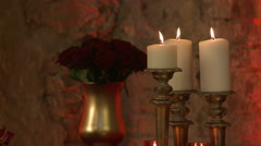 Flickering candles in loft-style interior Stock Footage