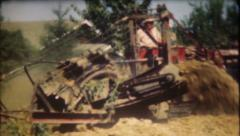 1319 - heavy duty digging for large pipeline near road - vintage film home movie - stock footage