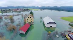 Farm with barnhouse in flooded water - stock footage